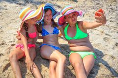 Girls making self portriat. On the beach Royalty Free Stock Image