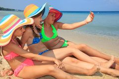 Girls making self portriat. On the beach Royalty Free Stock Photo