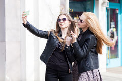 Girls making a selfie with the cellphone outside Stock Image