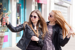 Girls making a selfie with the cellphone outside Royalty Free Stock Photo