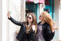 Girls making a selfie with the cellphone outside Royalty Free Stock Images