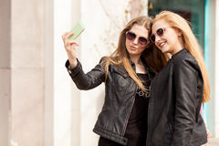 Girls making a selfie with the cellphone outside Stock Photo