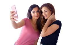 Girls making selfie. Two cute girls making selfie with smartphone Stock Photography