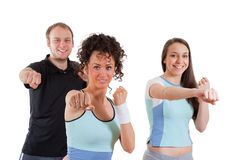 Girls and man fitness exercising together smiling Stock Photography