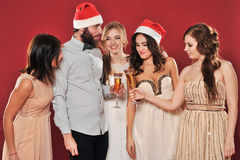 Girls and man with a glass of champagne Royalty Free Stock Photo
