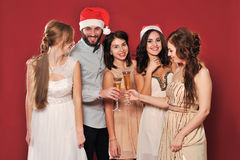 Girls and man with a glass of champagne Royalty Free Stock Image