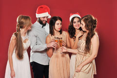 Girls and man with a glass of champagne Royalty Free Stock Images