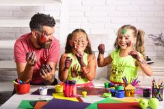 Girls and man with painted hands and faces Royalty Free Stock Photo