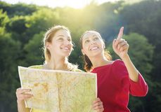 Girls with map Royalty Free Stock Images
