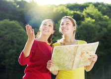 Girls with map Royalty Free Stock Image