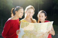 Girls with map Stock Photography