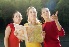 Girls with map Stock Photos