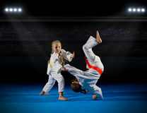 Girls martial arts  fighters. At sports hall Stock Image