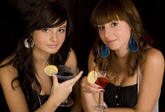 Girls with martini Royalty Free Stock Photos