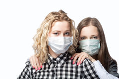 Girls in masks Stock Photography