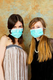 Girls with masks Royalty Free Stock Image