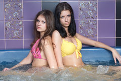 Girls in massage bath Royalty Free Stock Image