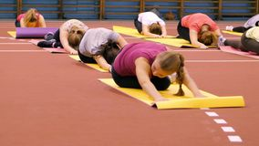Girls on the mats at the gym doing exercise Royalty Free Stock Images