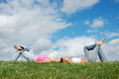Girls on the meadow. Two girls resting on the meadow Royalty Free Stock Images
