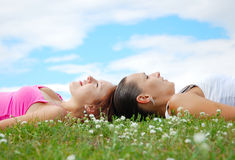 Girls on the meadow. Girls resting on the green meadow Stock Photo