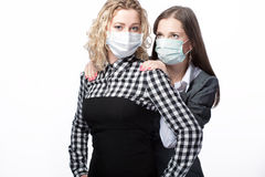 Girls in medical masks Stock Photography