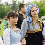 Girls in medieval costumes Stock Image