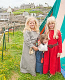 Girls in medieval dress at Portsoy. Three girls in medieval dress at the traditional Scottish Portsoy Boat Festival held on 16th and 17th  June 2013 Stock Images