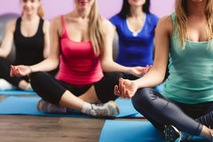 Girls meditate to restore strength and breath. Royalty Free Stock Photos