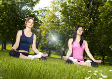 Girls meditating Royalty Free Stock Images