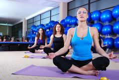 Girls meditating in fitness club royalty free stock image