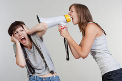 Girls with a megaphone Stock Image