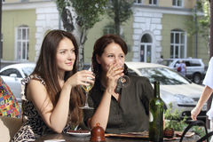 Girls met at lunch. Two girls sitting at a table in a street cafe Stock Image
