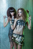 Girls with metal fetters Stock Images