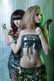 Girls with metal fetters Royalty Free Stock Photos
