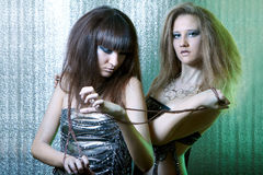 Girls with metal fetters Royalty Free Stock Image