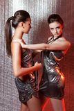 Girls with metal fetters. Beautiful girls with metal fetters royalty free stock images