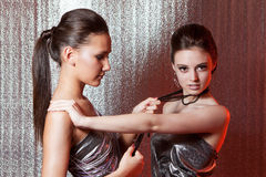 Girls with metal fetters. Beautiful girls with metal fetters Stock Images