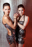 Girls with metal fetters. Beautiful girls with metal fetters royalty free stock photo