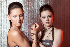 Girls with metal fetters Royalty Free Stock Photography