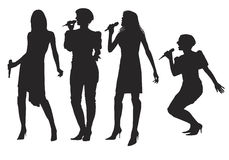 Girls with microphone. Girls singing with a microphone on the stage Stock Photo