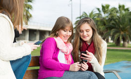 Girls mobile Stock Photography