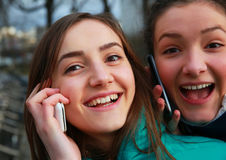 Girls with a mobile phones Royalty Free Stock Photo