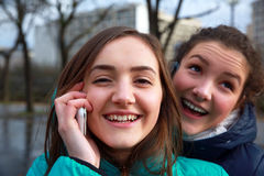 Girls with a mobile phones Stock Photography
