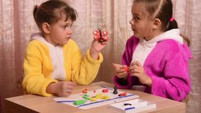 Girls molded articles made of plasticine sitting at table stock video footage