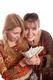 Girls with  money in hands. Young pretty girls with  money in hands Royalty Free Stock Photo