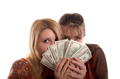 Girls with  money in hands. Young pretty girls with  money in hands Royalty Free Stock Photography