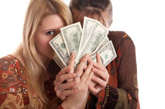 Girls with  money in hands Royalty Free Stock Photo
