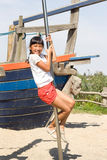 Girls at the Monkey Bar. Little girl on a climbing pole on playground Stock Photos