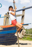 Girls at the Monkey Bar. Little girl climbing on a pole on the playground Royalty Free Stock Image