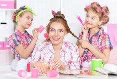 Girls with mother   in hair curlers Stock Images
